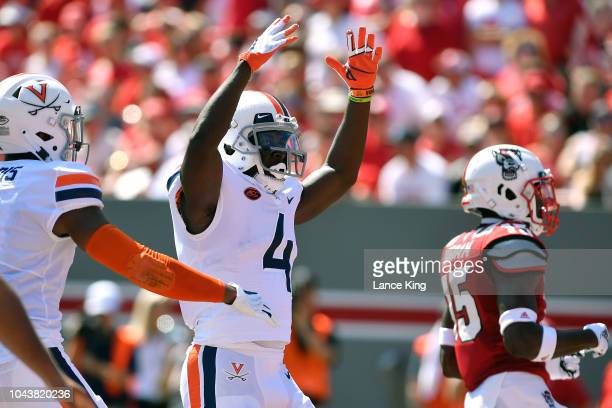 Olamide Zaccheaus of the Virginia Cavaliers celebrates his 35yard pass reception for a touchdown against the North Carolina State Wolfpack at...