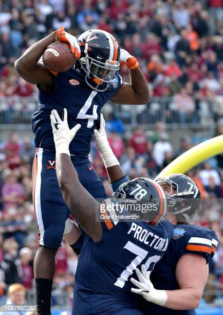 Olamide Zaccheaus of the Virginia Cavaliers celebrates with teammates after scoring a touchdown against the South Carolina Gamecocks during the first...