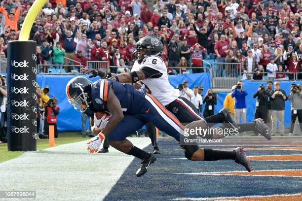 Olamide Zaccheaus of the Virginia Cavaliers makes a touchdown catch against RJ Roderick of the South Carolina Gamecocks during the first half of the...