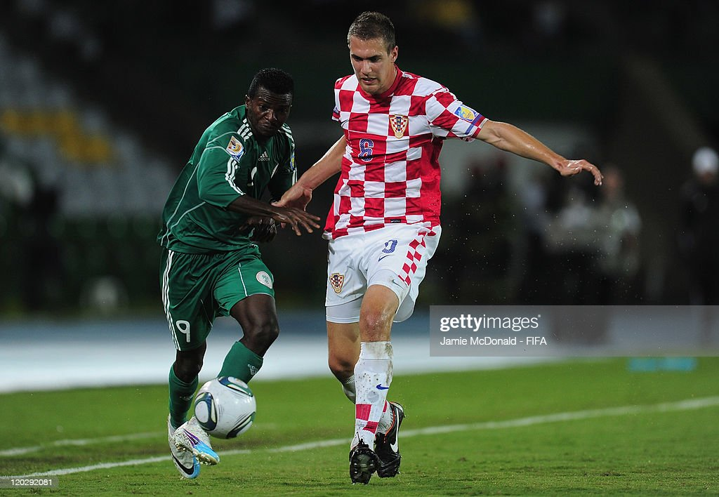 Olarenwaju Kayode of Nigeria battles with Tomislav Glumac of Croatia during the FIFA U-20 World Cup Group D match between Croatia and Nigeria at the Estadio Centenario on August 3, 2011 in Armenia, Colombia.