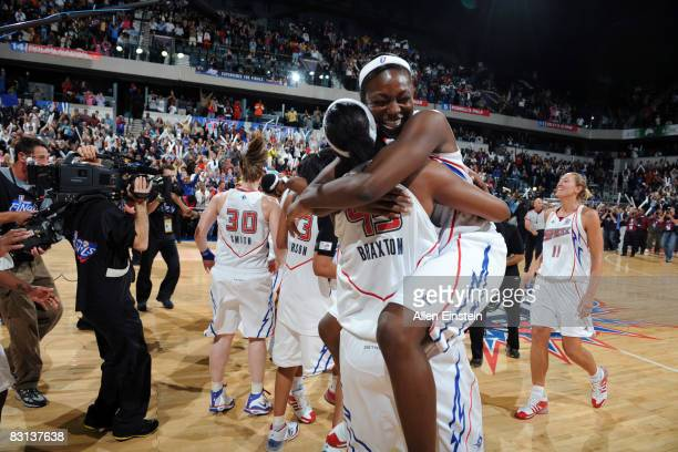 Olayinka Sanni jumps on Kara Braxton of the Detroit Shock after they win against the San Antonio Silver Stars in Game Three of the WNBA Finals to...