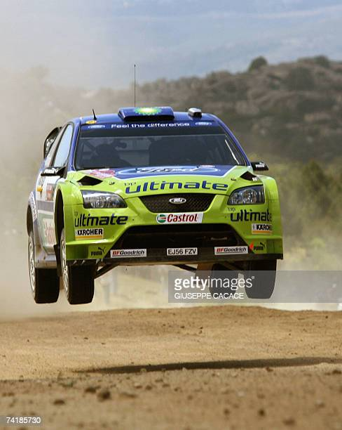 Finnish driver Marcus Gronholm with his codriver Timo Rautianinen powers his Ford focus RS WRC 06 during the Terranova special stage of the Italian...