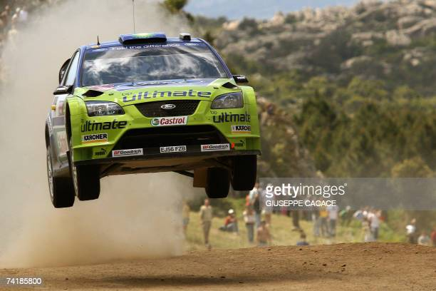 Finnish Mikko Hirvonen steers his Ford focus RS WRC 06 with codriver Jarmo Lehtinen during the Terranova special stage of the Italian rally in...