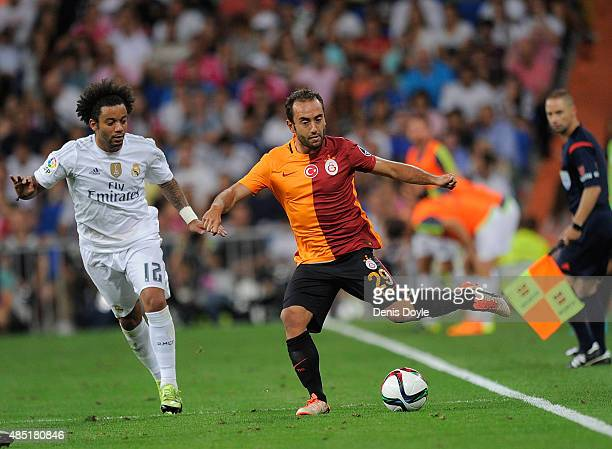 Olcan Adin of Galatasaray in action beside Marcelo of Real Madrid during the Santiago Bernabeu Trophy match between Real Madrid and Galatasaray at...
