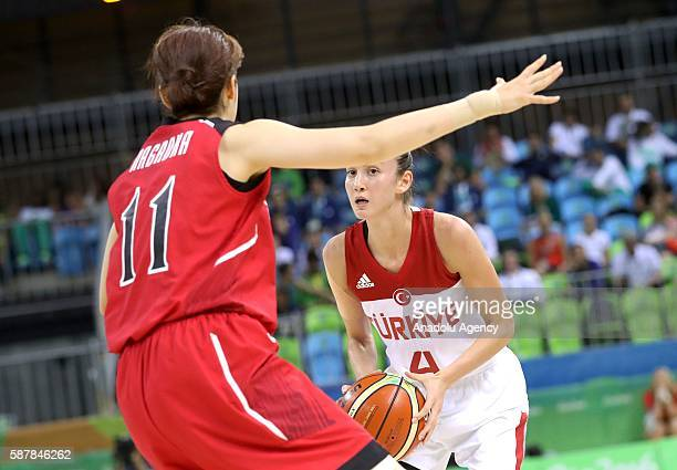 Olcay Cakir of Turkey in action against Moeko Nagaoka of Japan during a Women's Group A game between Turkey and Japan at the Rio 2016 Olympic Games...