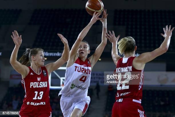 Olcay Cakir Turgut of Turkey in action against Maria Gajda and Daria Kaczmarczyk of Poland during the 2019 Women FIBA EuroBasket Qualification Group...