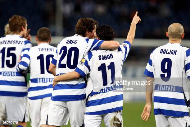 Olcay Sahan of Duisburg celebrates his team's second goal with team mates during the Second Bundesliga match between MSV Duisburg and TuS Koblenz at...