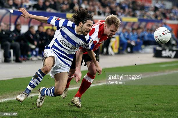 Olcay Sahan of Duisburg is challenged by Tom Geissler of Koblenz during the Second Bundesliga match between MSV Duisburg and TuS Koblenz at the MSV...