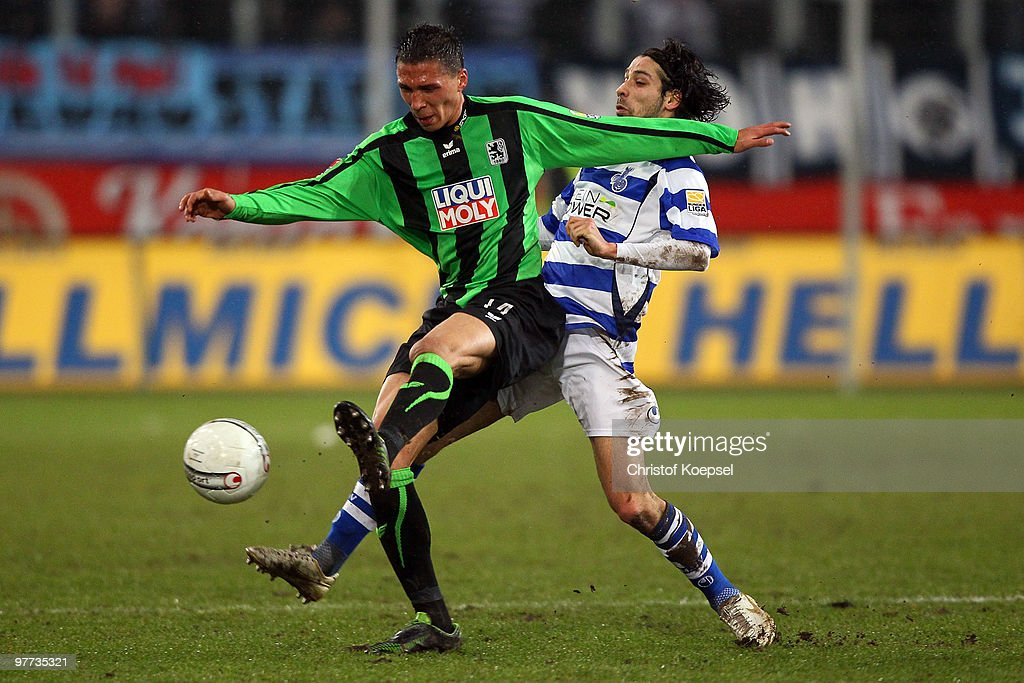 Olcay Sahan of Duisburg (R) tackles Jose Holebas of Muenchen (L) during the second Bundesliga match between MSV Duisburg and 1860 Muenchen at the MSV Arena on March 15, 2010 in Duisburg, Germany.