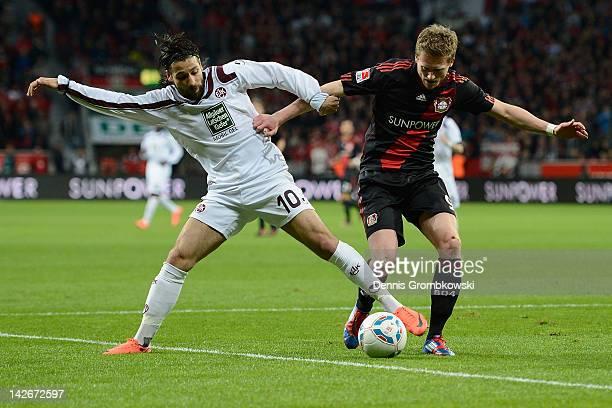 Olcay Sahan of Kaiserslautern and Andre Schuerrle of Leverkusen battle for the ball during the Bundesliga match between Bayer 04 Leverkusen and 1. FC...