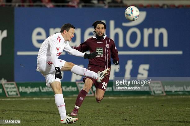Olcay Sahan of Kaiserslautern challenges Sascha Riether of Koeln during the Bundesliga match between 1. FC Kaiserslautern and 1. FC Koeln at...