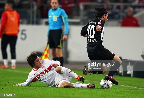 Olcay Sahan of Kaiserslautern is challenged by Gotoku Sakai of Stuttgart during the Bundesliga match between VfB Stuttgart and 1. FC Kaiserslautern...