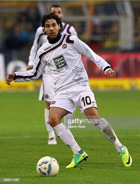 Olcay Sahan of Kaiserslautern runs with the ball during the Bundesliga match between Borussia Dortmund and 1. FC Kaiserslautern at the Signal Iduna...
