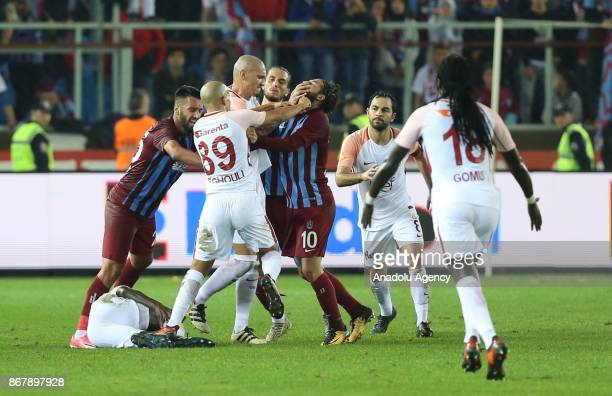Olcay Sahan of Trabzonspor and Feghouli of Galatasaray fight each other during a Turkish Super Lig match between Trabzonspor and Galatasaray at...