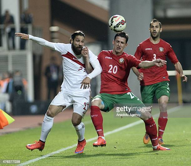 Olcay Sahan of Turkey vies for the ball with Alexander Tonev of Bulgaria during a friendly soccer match between Turkey and Bulgaria at the Kasimpasa...