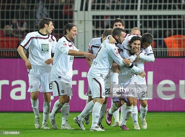 Olcay Sahin of Kaiserslautern celebrates scoring his goal with teamates during the Bundesliga match between Borussia Dortmund and 1. FC...