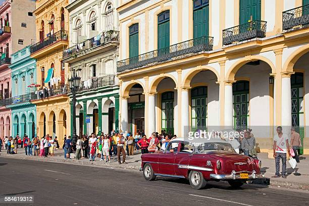 Old 1950s vintage American car / Yank tank on the Prado avenue / Paseo del Prado in Havana, Cuba, Caribbean.