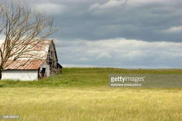 Old, Abandoned Barn in Field with Overcast Sky