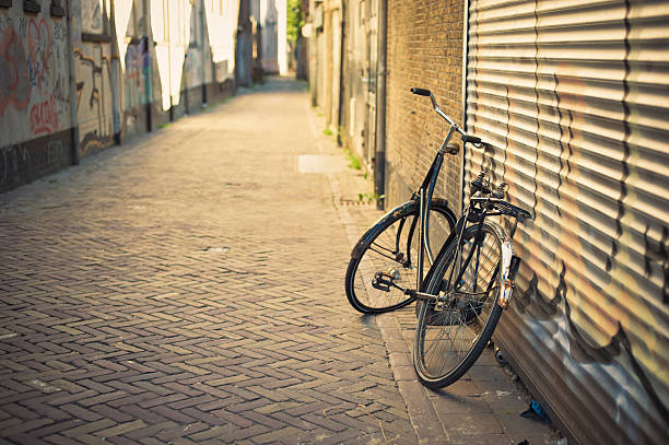 Old Abandoned Bicycle Leaning On The Wall In Delft, Netherlands Wall Art