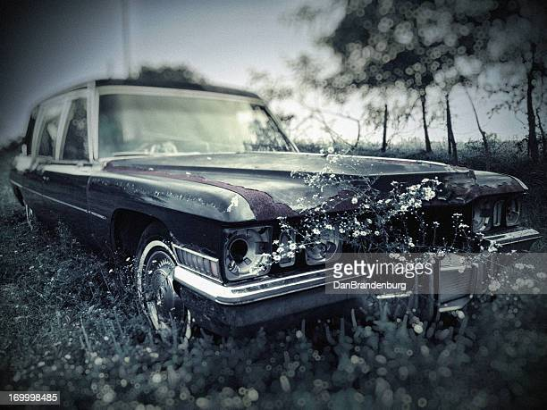 old abandoned hearse in cemetery - hearse stock photos and pictures