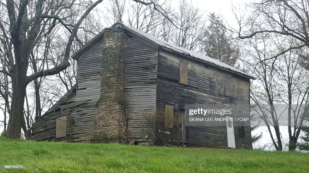 Old abandoned house on the grassy land : Stock Photo