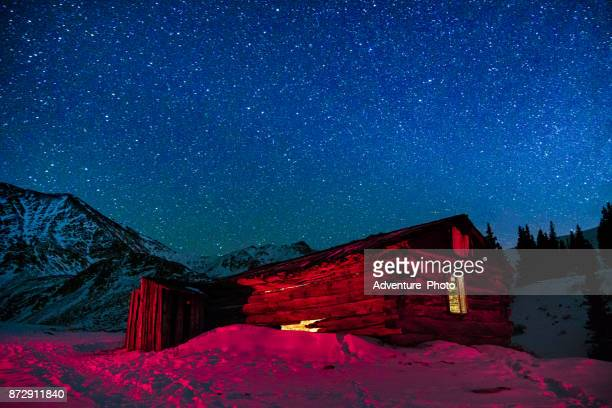 Old Abandoned Mining Buildings and Starry Milky Way Stars