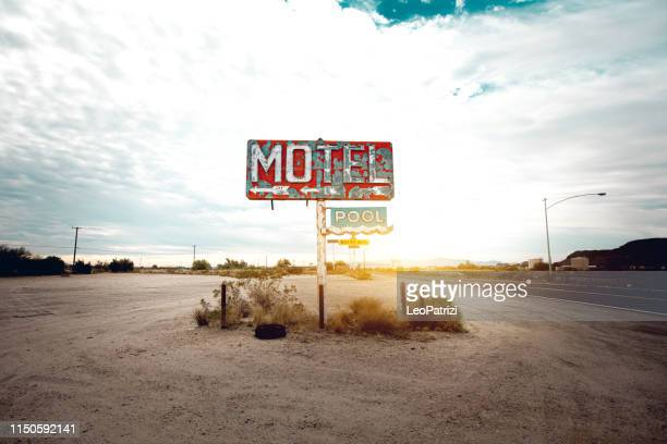 old abandoned motel sign in arizona - bad condition stock pictures, royalty-free photos & images