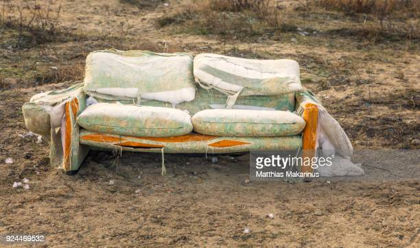 old abandoned sofa - makarinus stock photos and pictures