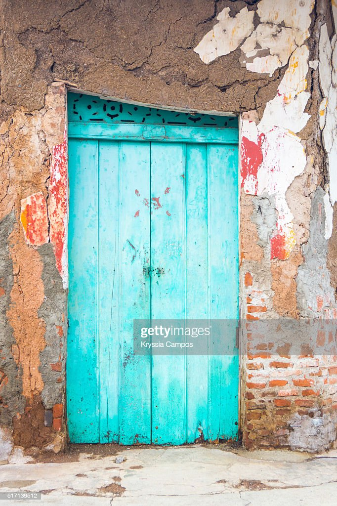 Old abandoned turquoise door in Granada, Nicaragua : Stock Photo