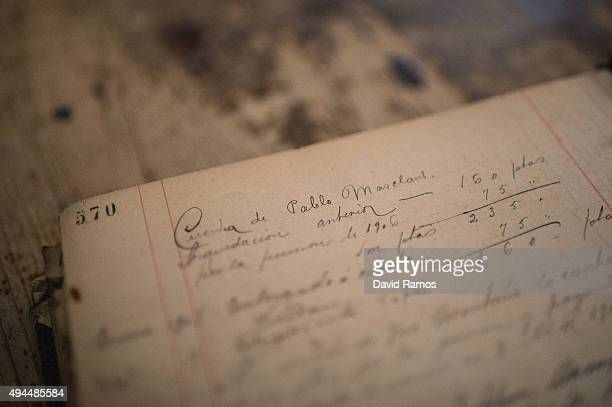 Old accounting documents are seen at Sanmarti factory on October 27 2015 in Caldes de Montbui Spain The Sanmarti family has been involved in the...