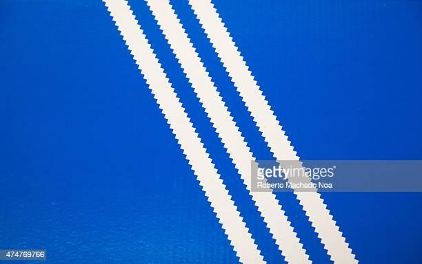 Old Adidas logo Three white stripes on a blue background shoebox lid