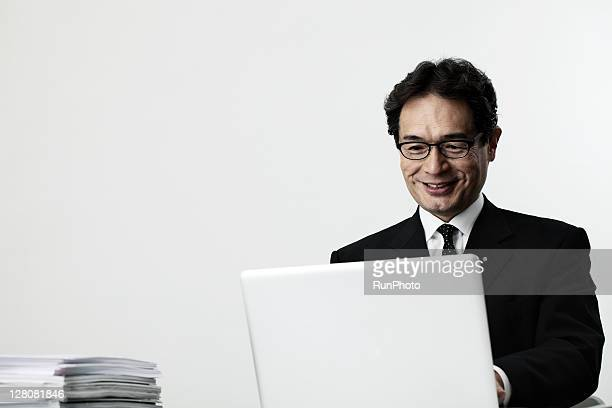 old age businessman using a computer
