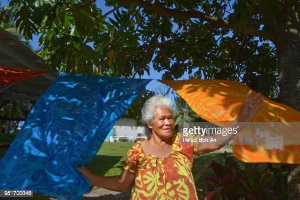 old aged pacific islander womqn waving hello / goodbye - rafael ben ari fotografías e imágenes de stock