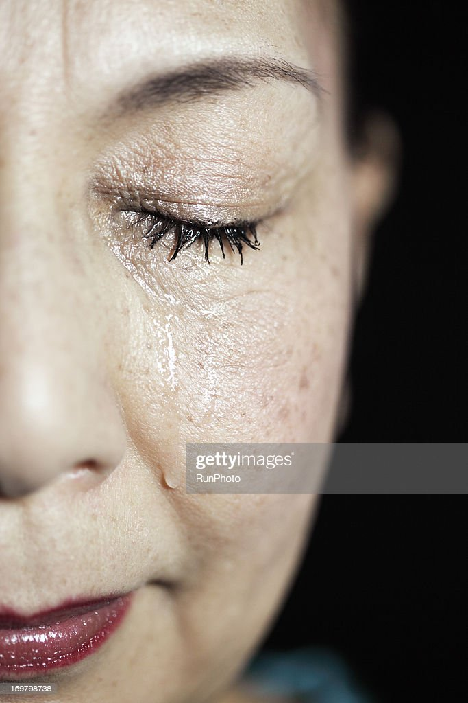 Old aged woman crying : Stock Photo