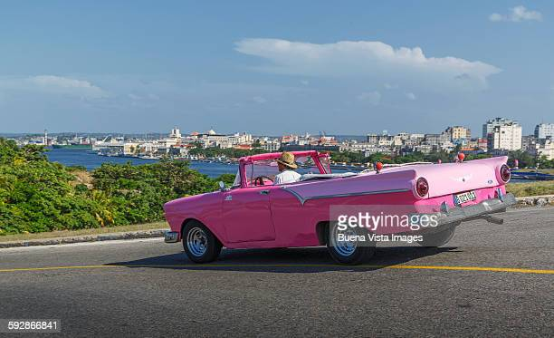 Old American car and view of Havana