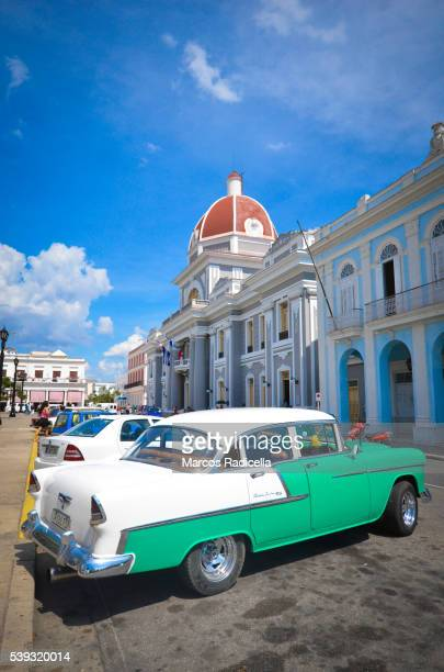 old american car in cienfuegos main square - radicella stock photos and pictures