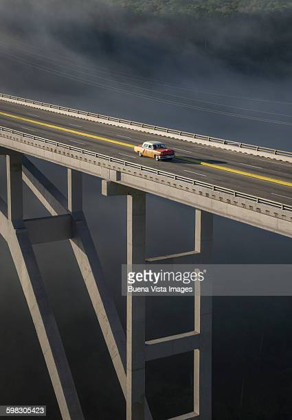 Old american car on a modern bridge