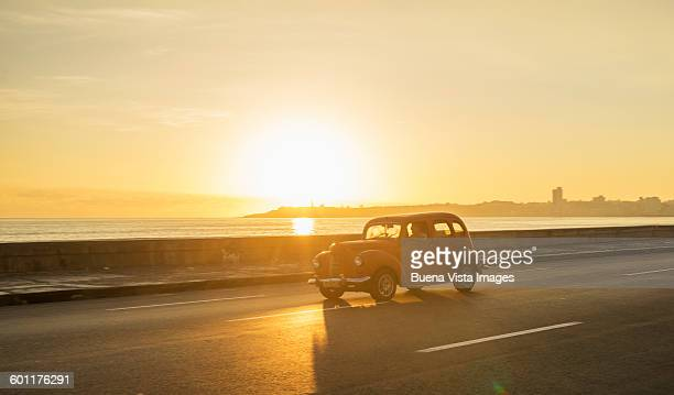 Old american car on El Malecon of Havana