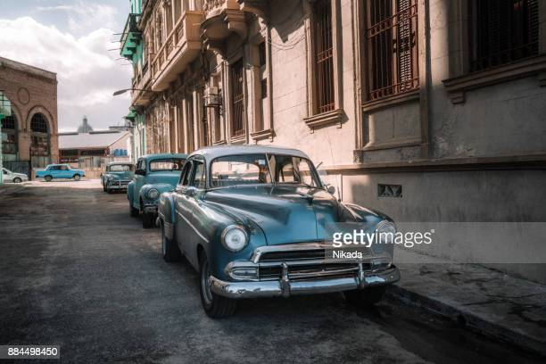 old american car on havana street - cuba 1950s stock photos and pictures