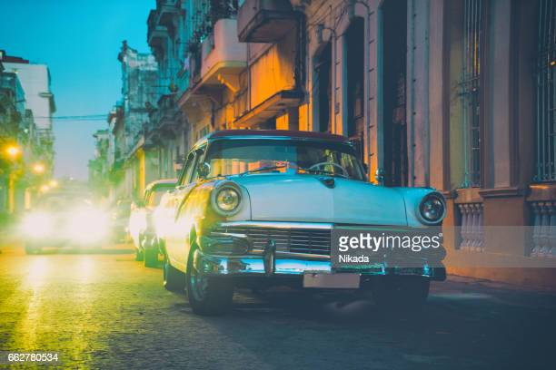Old American car on street at dusk, Havana, Cuba