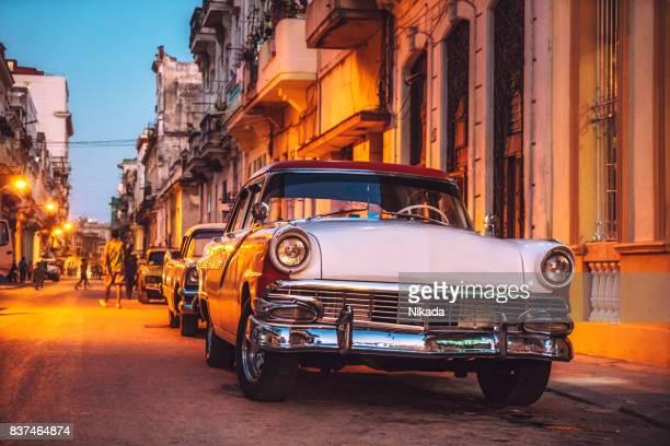 Old American car on street at dusk, Havana, Cuba