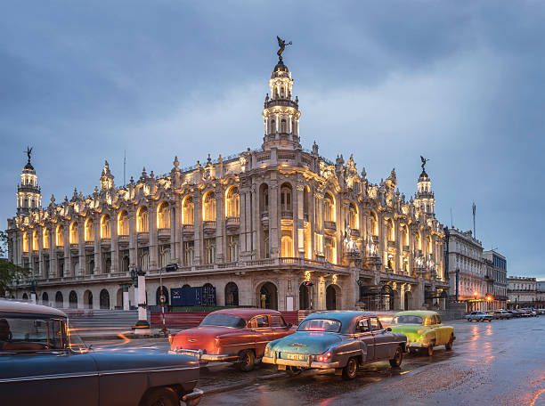 Old American Cars And The Cuban National Theater Wall Art