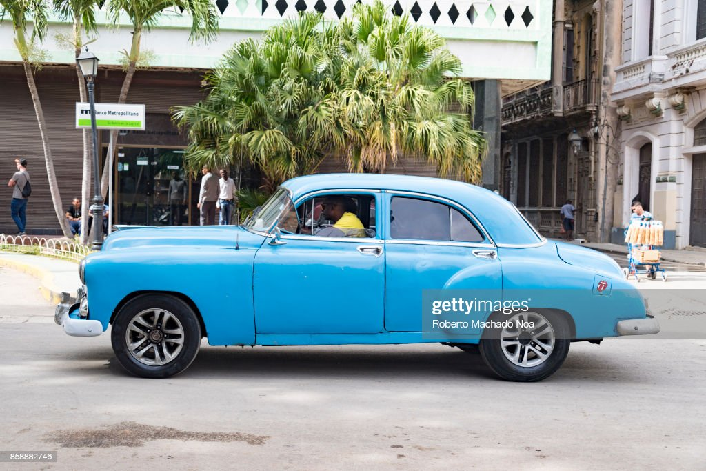Old American cars in action  Blue Golden Chevrolet 1949 or