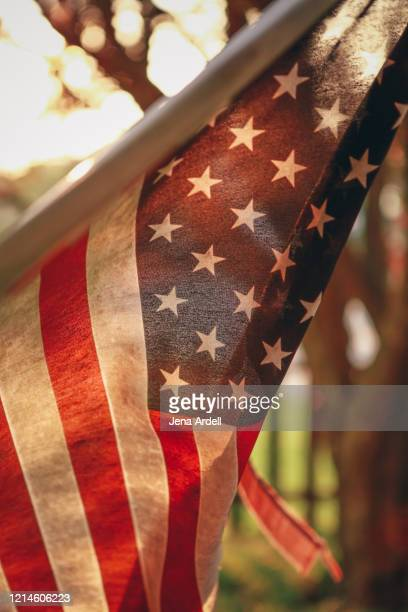 old american flag in patriotic small town, usa - memorial day background stock pictures, royalty-free photos & images