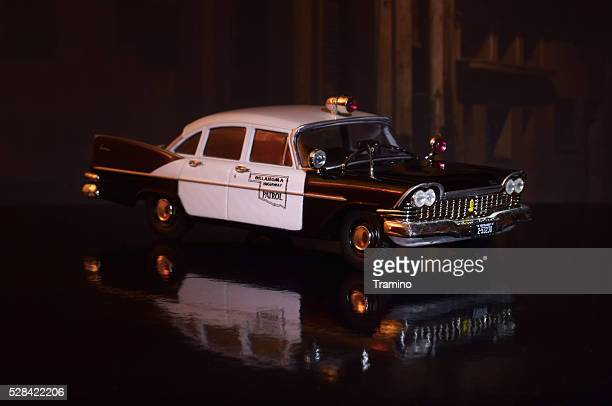 old american police car model at night - law enforcement appreciation stock pictures, royalty-free photos & images