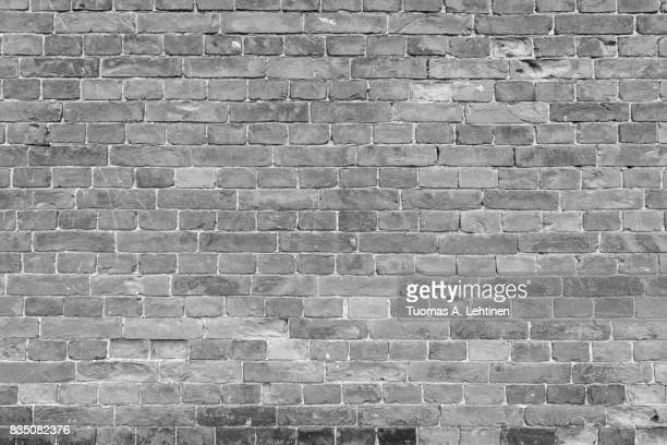 Old and aged brick wall texture background in black and white.