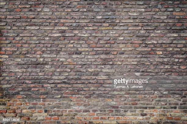 old and aged red brick wall texture background with vignette. - brick wall stock pictures, royalty-free photos & images