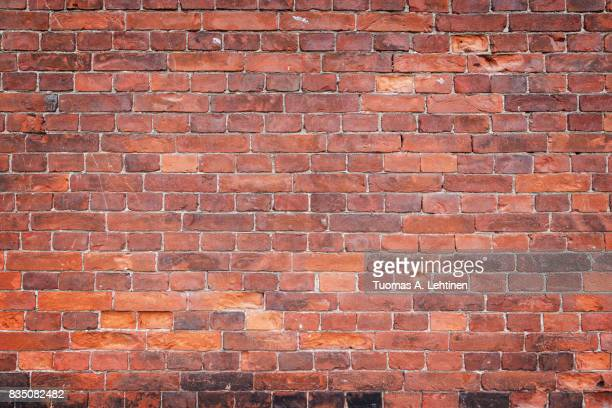 old and aged red brick wall texture background with vignetting. - mattone foto e immagini stock