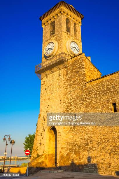 old and classic clock tower. cannes, provence-alpes-côte d'azur, france. - copyright by siripong kaewla iad ストックフォトと画像