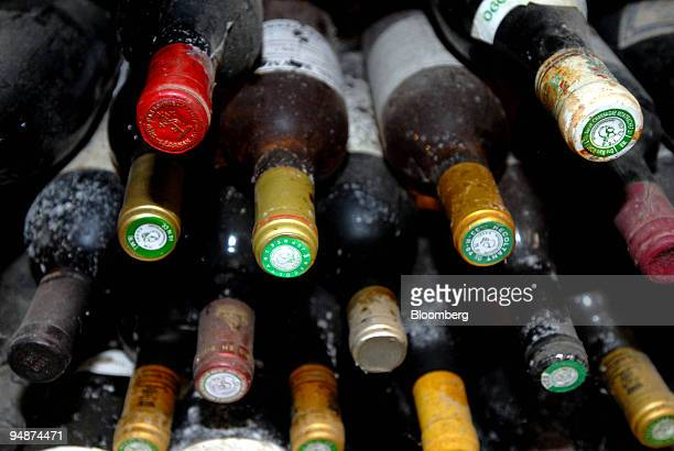 Old and dusty wine bottles sit in the cellar at the Clos Saint Jean vineyard, in the Burgundy village of Chassagne-Montrachet, France, on Tuesday,...